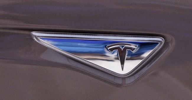 Tesla beats Wall Street forecasts on record quarterly sales