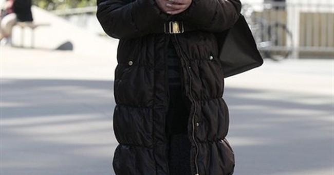 Woman in DuPont economic espionage case pleads guilty