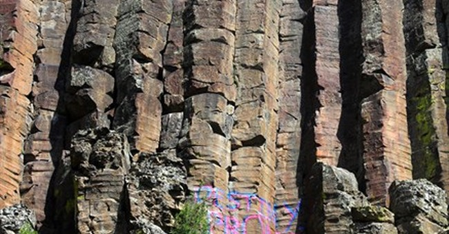 Teen who spray-painted prom invite on Idaho cliff sought