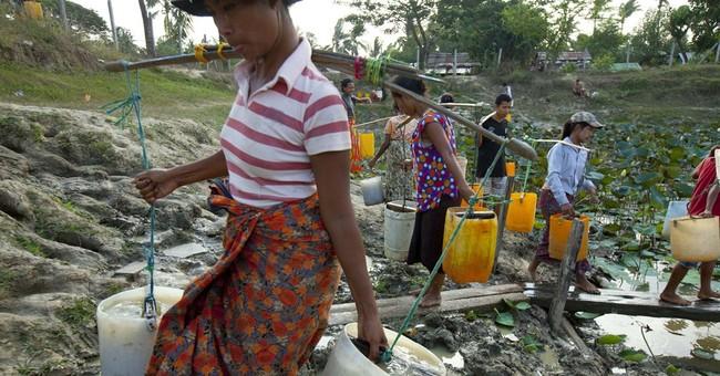 Image of Asia: Fetching water during dry season in Myanmar
