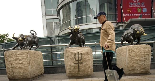 Beijing tries to tap brakes on stock market boom