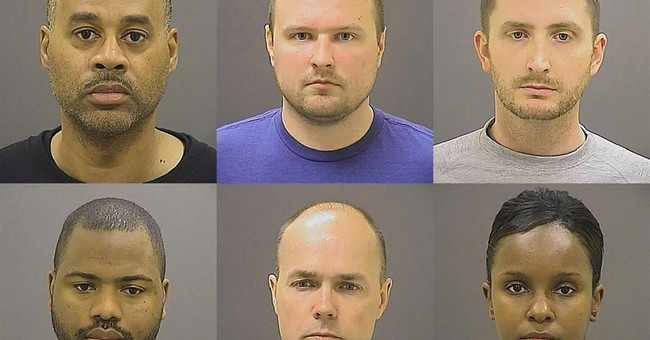 Officers charged in arrested man's death want case dismissed