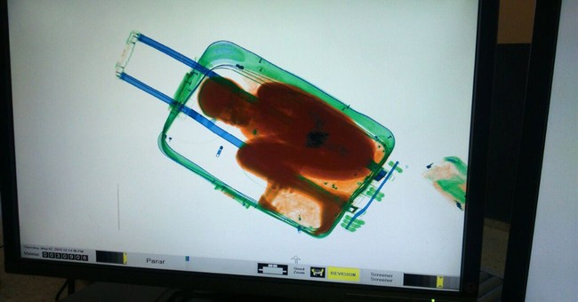 Correction: Spain-Boy in Suitcase story