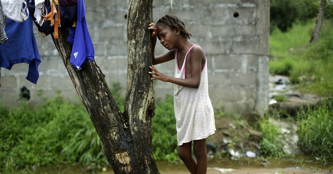 Liberia cautiously marks end of Ebola after 4,700 deaths