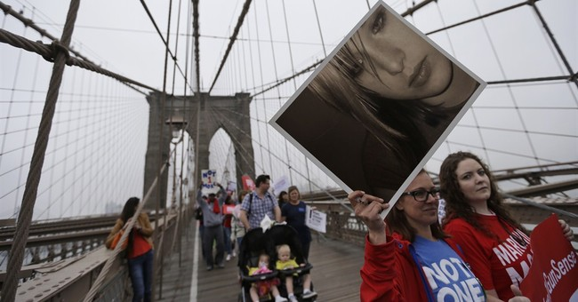 Hundreds march across Brooklyn Bridge for stricter gun laws