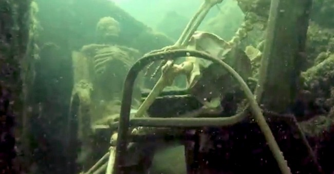 Couple behind fake skeletons on chairs in Colorado River