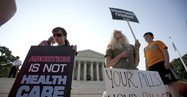AP-GfK Poll: Doubts on court's fairness in health law case
