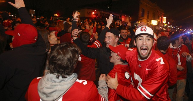 Ohio State football revelers set fires, tear down goal post