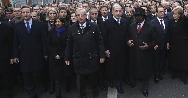 French president comforts, unites nation in crisis
