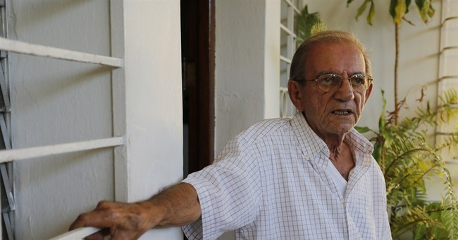 APNewsBreak: Sister: Cuban spy hailed by Obama fine, in US