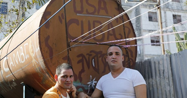 Freed Cuba dissidents say detente will help push for change