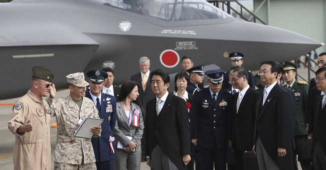 Japan Cabinet OKs record military budget with eye on China