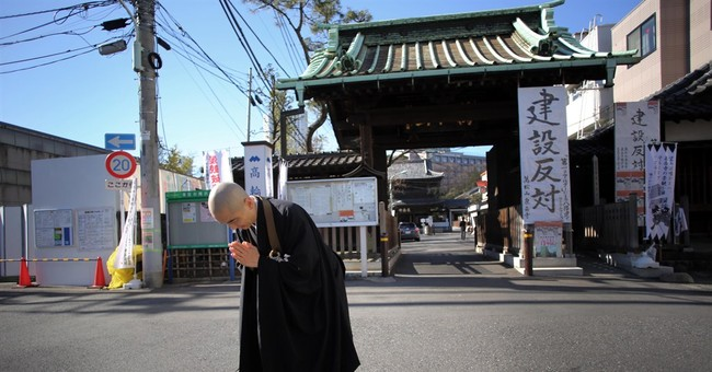 Condo to loom over samurai graves in Japan, spurring protest