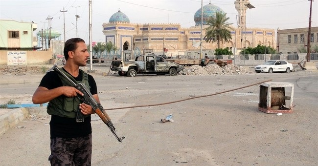 Bombings kill at least 14 in, outside Baghdad
