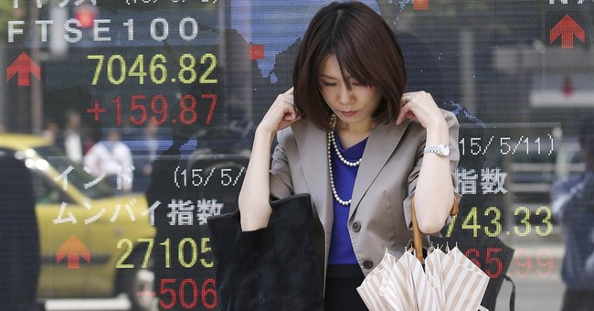 Europe stocks down on Greece, China rate cut spurs Asia