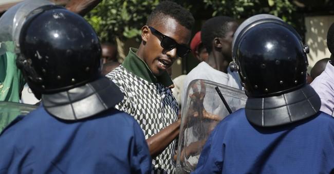Protesters march again in Burundi's capital despite ban