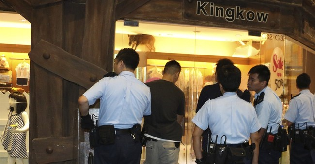 Consumer culture gone wild: Boar visits Hong Kong mall