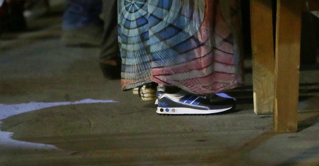 In Italy, seized knock-off shoes go to help new migrants