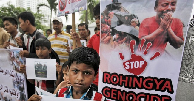 Activist: Rohingya at sea without food, water beg for rescue