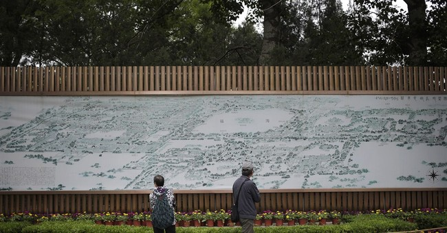Replica of razed Chinese palace opens, but some prefer ruins
