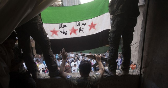 Flag dispute sparks divisions, mistrust in Syria opposition