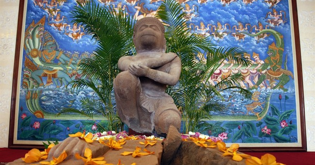 Cambodia welcomes home 10th century statue of a Hindu god