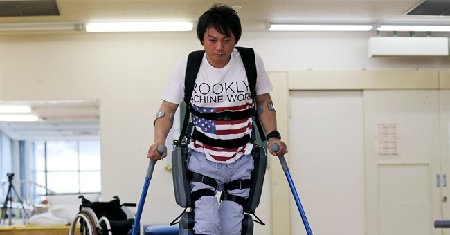 Exoskeleton that helps paralyzed walk faces barrier in Japan