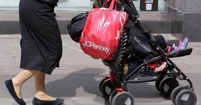 J.C. Penney posts smaller 1Q loss, raises sales guidance