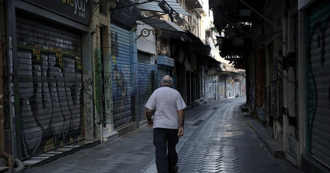 Greek leader to hold government meeting as recession returns