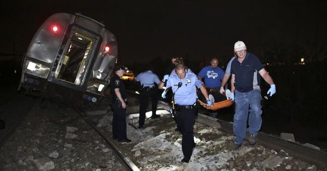 The Latest on Amtrak crash: College dean died in crash