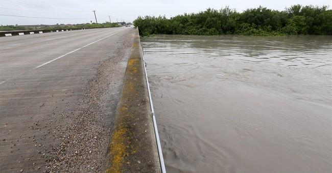 Heavy rain swamps parts of Houston area, vehicles abandoned