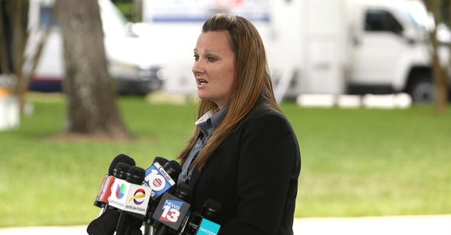 George Zimmerman awaits police probe in shooting on road
