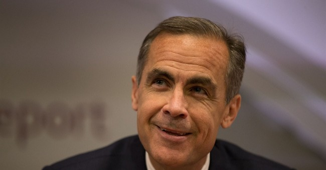 Bank of England cuts forecasts, dims rate hike prospects