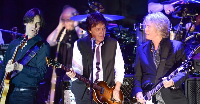 Paul McCartney plays private concert for execs, stars