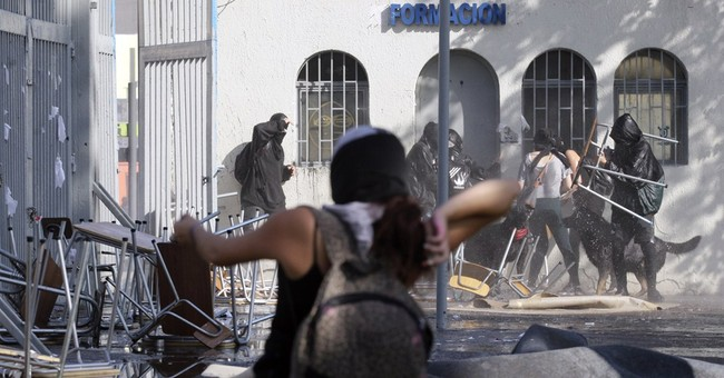 Chile: 2 people shot to death after student protest