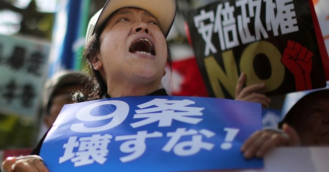 Japan's Cabinet endorses bills to allow greater defense role