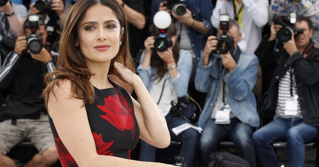 CANNES WATCH: Salma Hayek eats Cannes' heart out