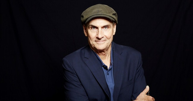 James Taylor says Obama is great; riding Hillary train