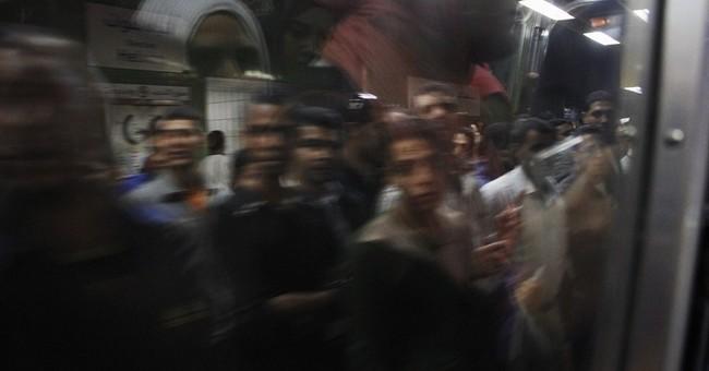 AP PHOTOS: Cairo subway thrives beneath the chaos