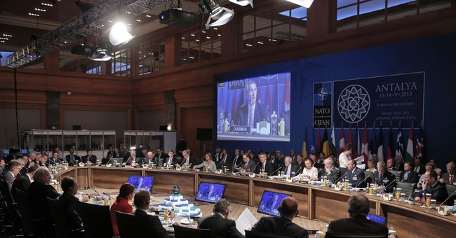 "European officials sing ""We Are the World"" at NATO meeting"