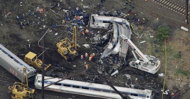 The Latest on Amtrak crash: Amtrak CEO apologizes for wreck