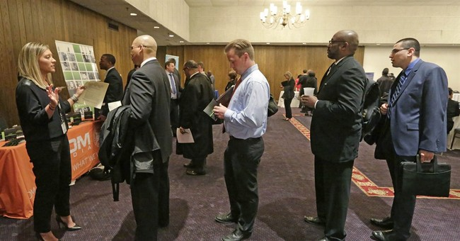 Monthly average of unemployment claims falls to 15-year low