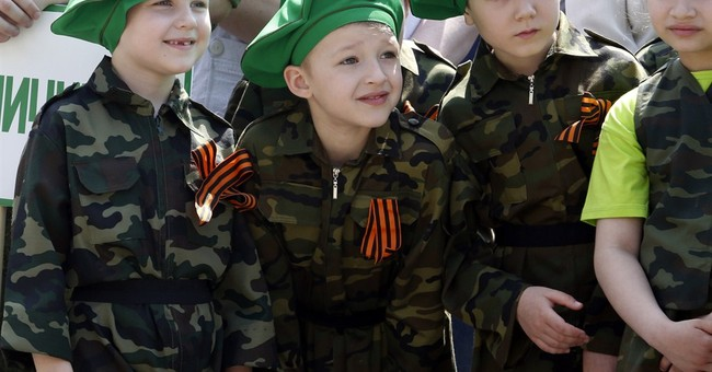 Children in southern Russia put on WWII Victory Day parade