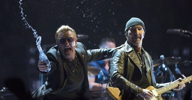 U2's The Edge falls off stage in Vancouver