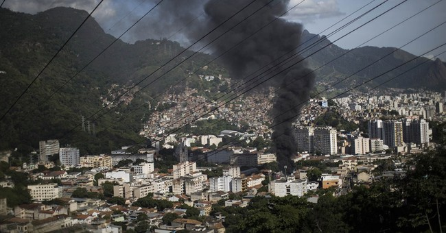 Protest against slum violence hits downtown Rio