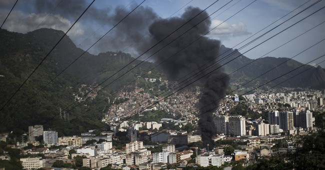 Protest against slum violence hits downtown Rio