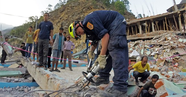 US team pulls woman from collapsed 4-story building in Nepal