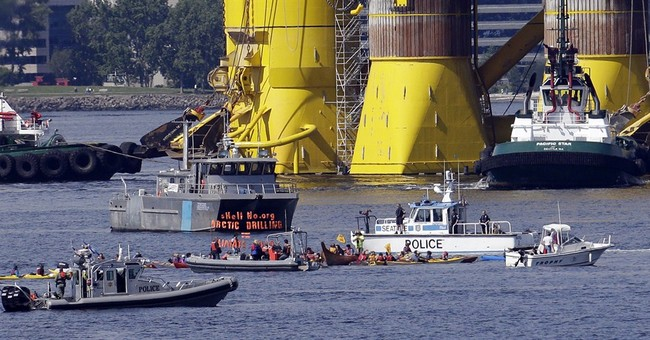 Kayakers protest as Arctic drill rig moors off Seattle