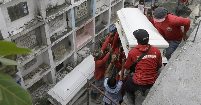 Philippine factory where 72 died suspected of breaking law