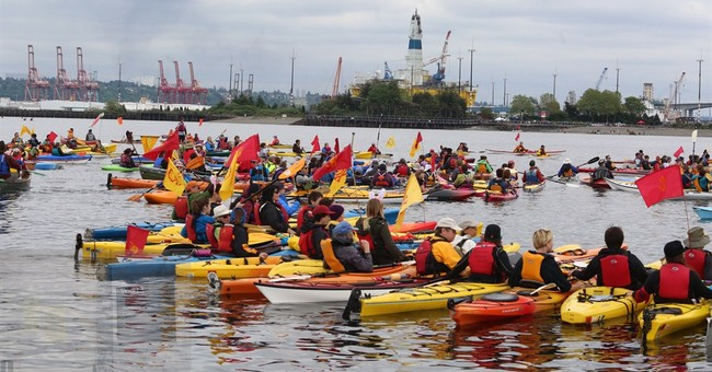 Anti-Arctic drilling kayaktivists hold 'Shell No' protest